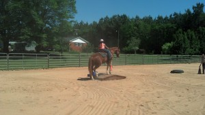 First-grader doing a riding demonstration for her class.
